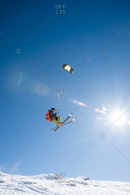 February 17, 2015: Full length shot of man in mid-air while snowkiting
