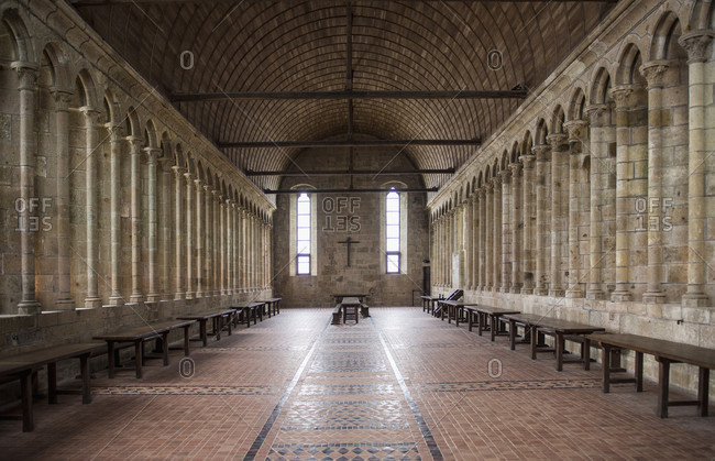 January 8, 2018: Photograph of interior of dining hall in monastery of Mont Saint-Michel, Normandy, France