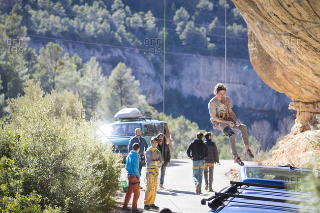 March 7, 2018: Male climber getting lowered from popular climbing crag, Margalef, Catalonia, Spain