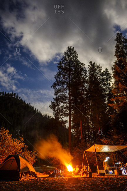 April 28, 2018: View of campsite with campfire at sunset near Salmon River, Idaho, USA