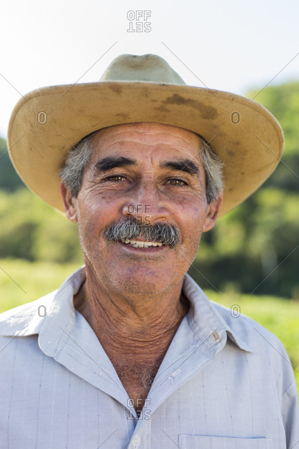 March 10, 2017: Headshot portrait of smiling farmer in hat, Vinales, Pinar del Rio Province, Cuba