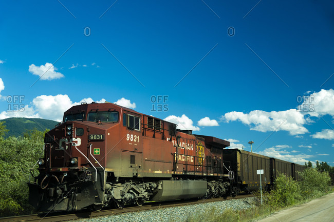 July 24, 2016: View of train on railroad tracks in Banff National Park, Alberta, Canada