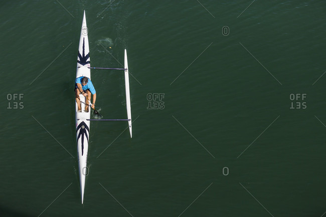 April 24, 2016: Directly above view of kayaker paddling in kayak