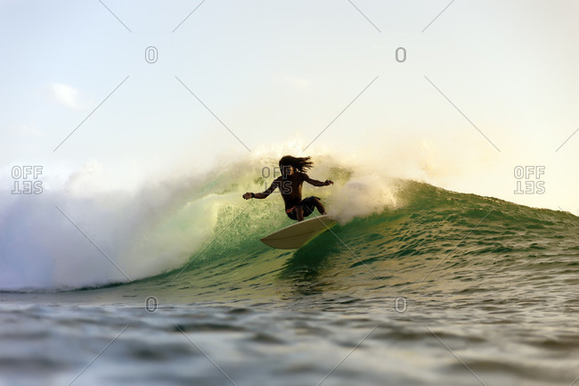 February 1, 2018: Silhouette of surfer riding wave in sea