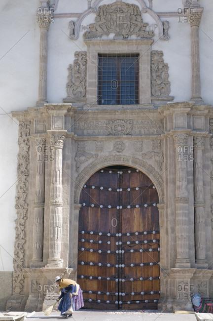 June 14, 2017: Large wooden gate of church, La Paz, Bolivia