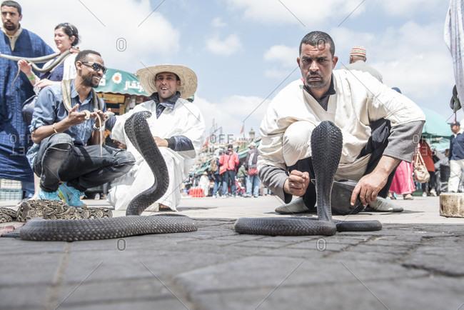 April 3, 2018: Snake charmer snake charmers in Djemaa El Fna square of Marrakesh, Morocco