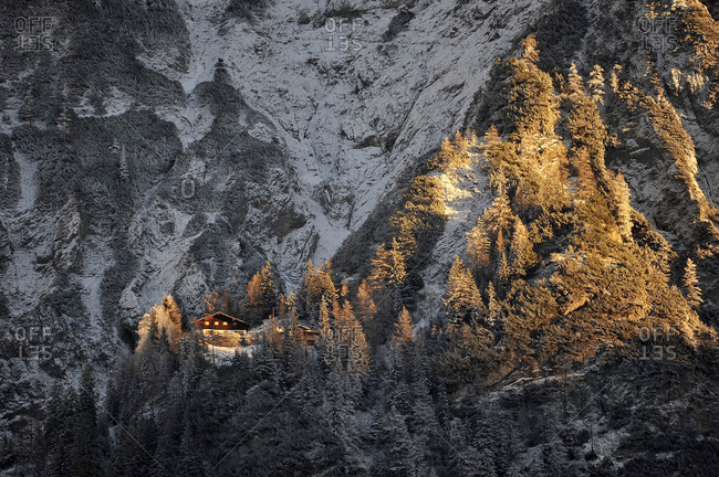 Mittenwalder hut in the western Karwendel over Mittenwald in the last evening light. The hut are on the just still projection on the bottom left shone on from the sun.
