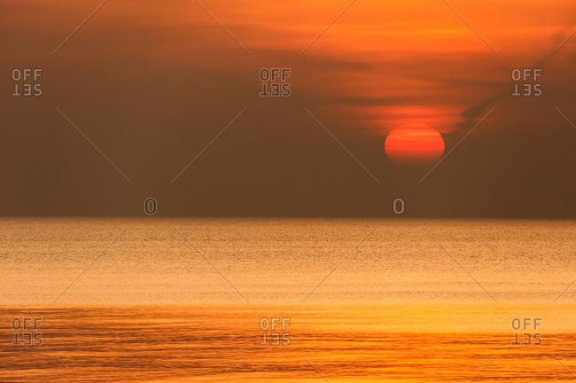 Red sundown by the sea.