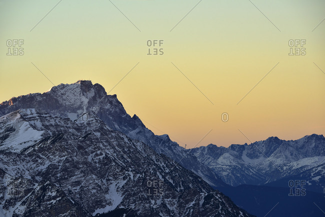 Zugspitze with snow in the gentle wintry evening light.