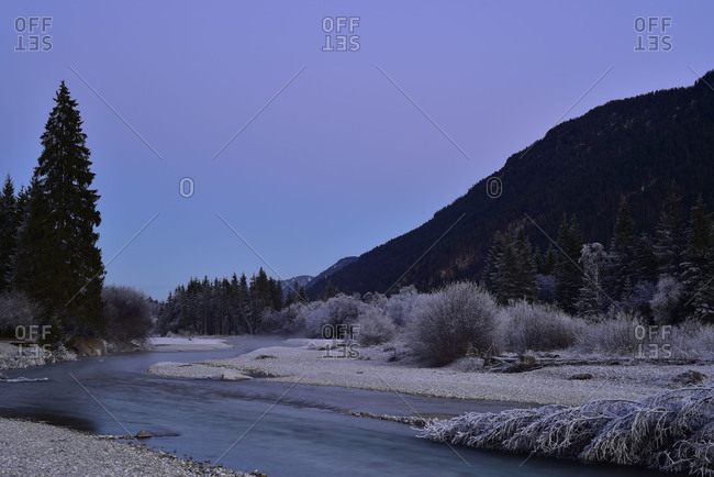 Course of the Isar river between Wallgau and Vorderiss in the lilac evening light of the sundown. The scenery is easily covered with hoarfrost.