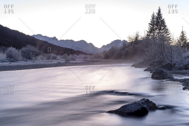Sundown on the Isar with view to Zugspitze and Wetterstein Range in frost and hoarfrost.