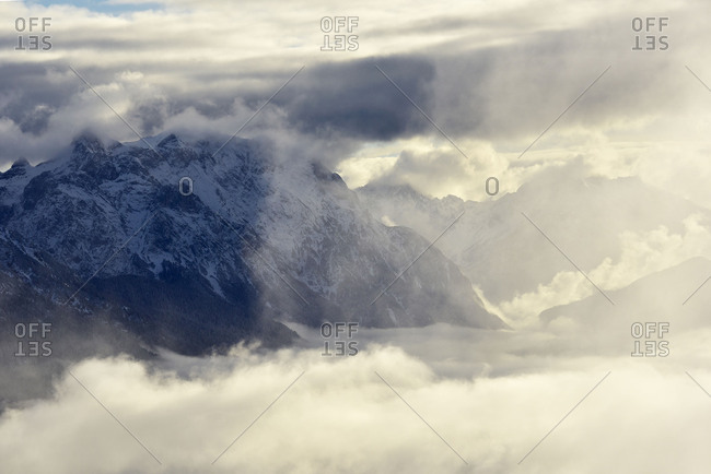 View at the western Karwendel above Mittenwald, with deep fog and dramatic beautiful clouds.