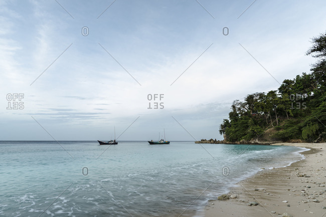 Two fishing boats in a small lagoon on the beach of the Fantastically nice island Pulau woe in Indonesia.