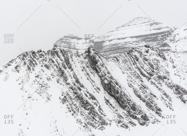 The Soiernspitze in the Karwendelgebirge (mountains) in winter. Bare rock looks under the snow out and underlines the inhospitableness of the high mountains. During a bivouac tour taken photos.
