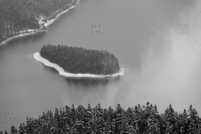 The island Sassau in the Walchensee, wintry snowbound scenery.