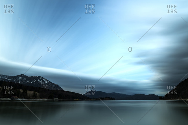 bluish beautiful clouds of a long time exposure of the Walchensee with Herzogstand.