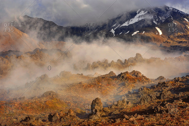 The level of Mordor. Early morning fog in the Oturere Valley of the Tongariro national park, a rocky volcano scenery in New Zealand.