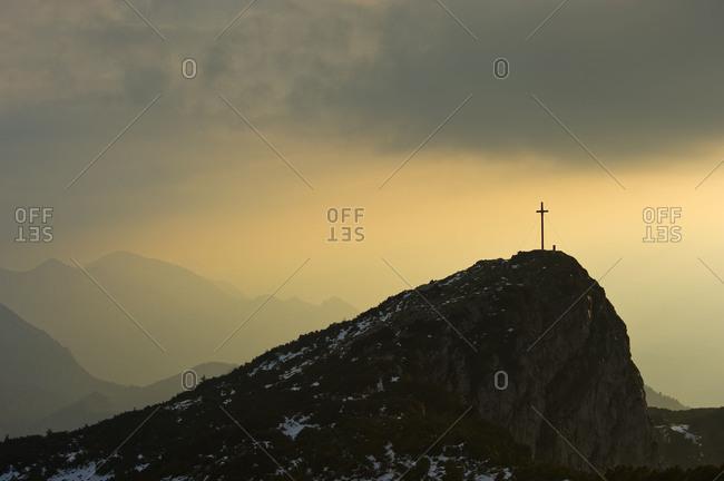 Summit cross of the Benediktenwand in the last natural light