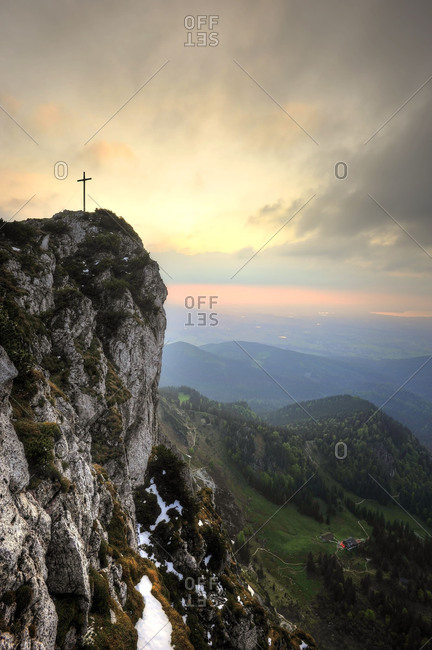 View to the summit cross of the Benediktenwand and the Tutzinger hut during sundown