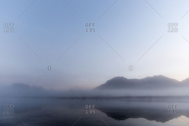 The Schmalensee (lake) between Garmisch-Partenkirchen and Mittenwald in the morning fog, in the background the Karwendelgebirge (mountains).