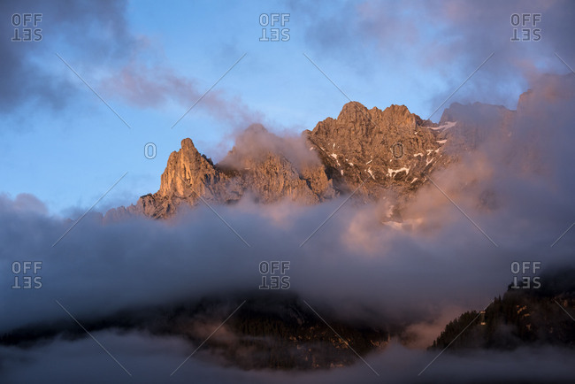 Evening light with dramatic fog and beautiful clouds over the western side of Karwendel mountains, over Mittenwald