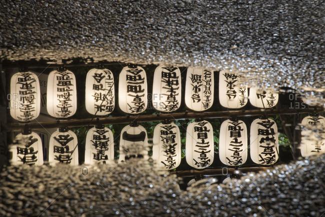 Asia, Japan, Nihon, Nippon, Tokyo, Taito, Asakusa, lanterns are reflecting in the puddle of rain