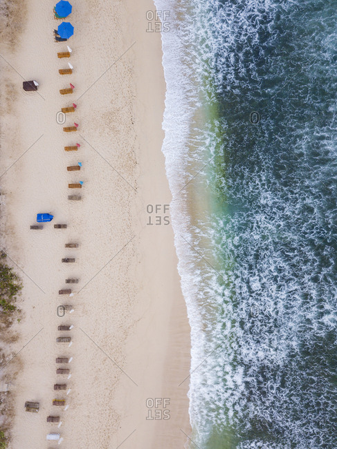 Indonesia- Bali- Aerial view of Balangan beach- empty sun loungers