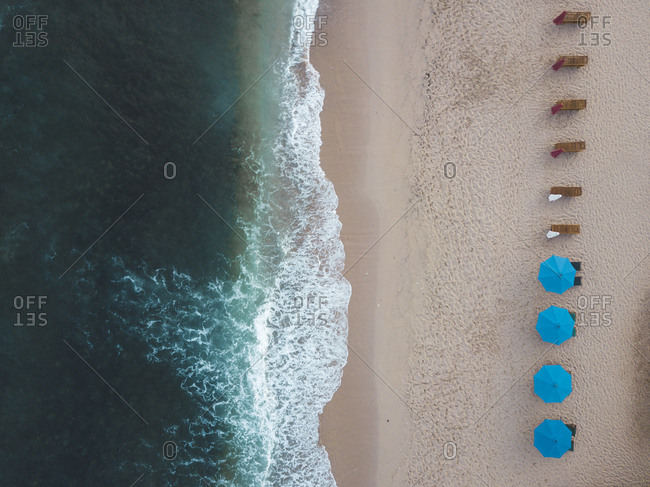 Indonesia- Bali- Aerial view of Balangan beach- empty sun loungers