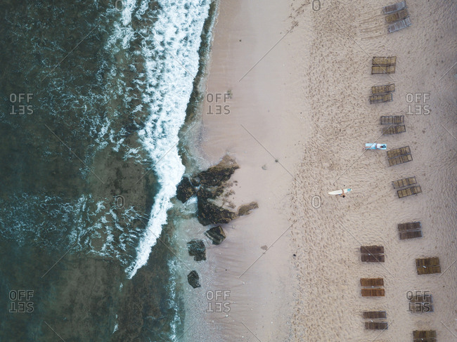 Indonesia- Bali- Aerial view of Balangan beach- empty beach loungers from above
