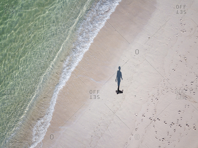 Indonesia- Bali- Aerial view- beach stroll- shadow of person