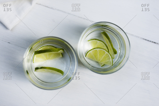 Two glasses of water with sliced limes