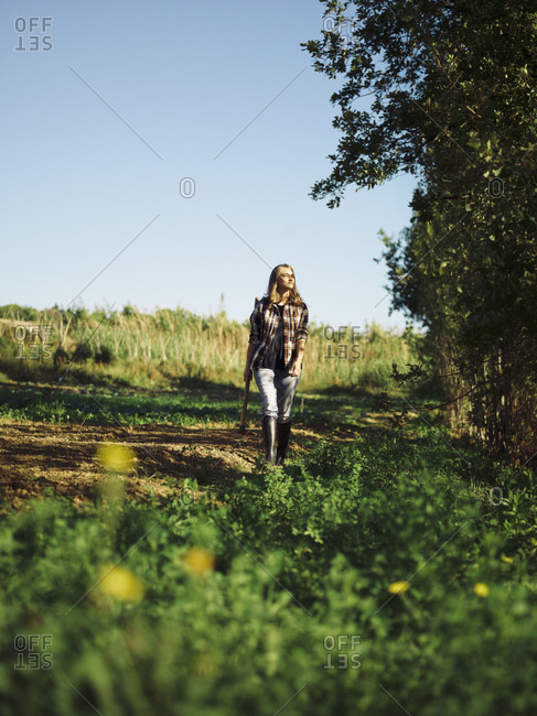 Farmer walking on a field