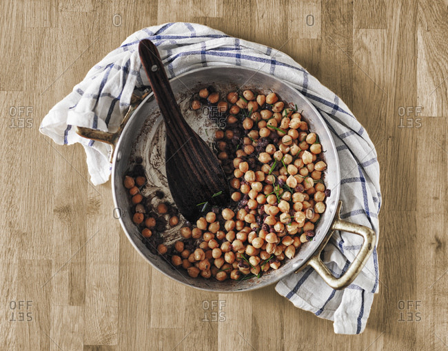 Cooking pot of chickpeas and beans with rosemary