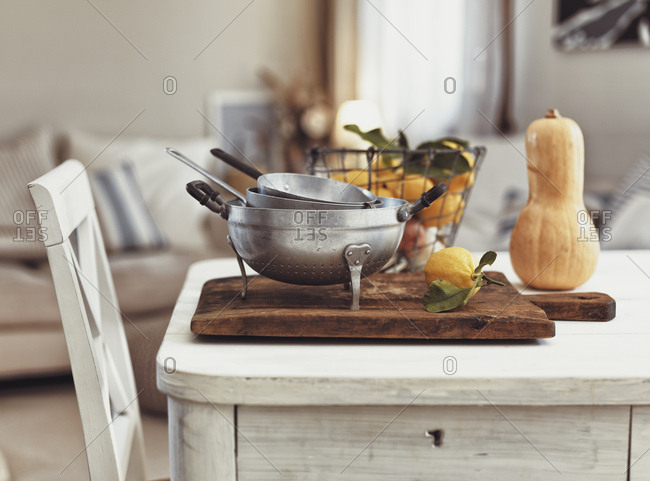 Nostalgic kitchen utensils and fruits on old wooden table