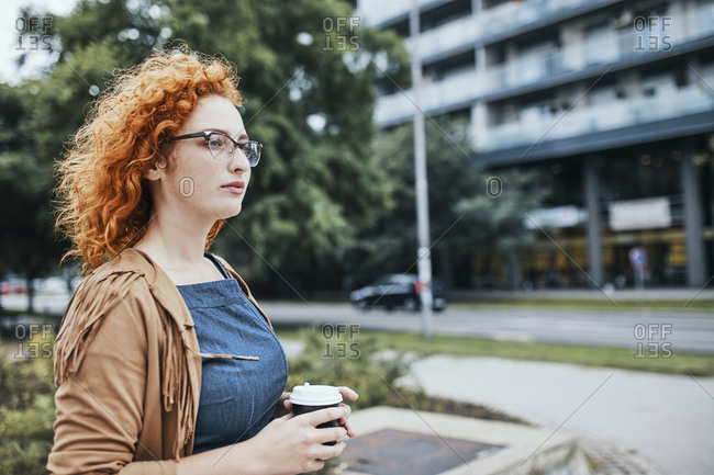 Woman going to work with a take out coffee
