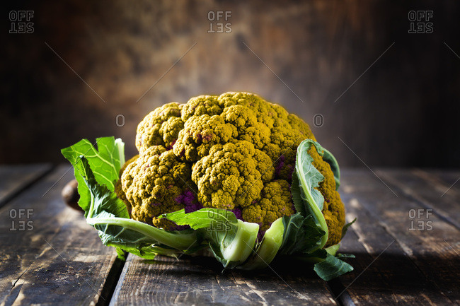 Yellow cauliflower on dark wood
