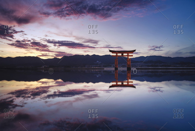 Japan- Hiroshima- Miyajima- Itsukushima Shrine at Seto Inland Sea at sunset