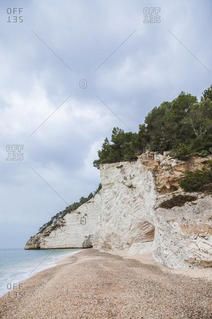 Italy- Vieste- empty Vignanotica Beach on a rainy winter day