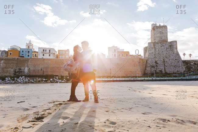 Italy- Molise- Termoli- young couple in the beach at sunrise