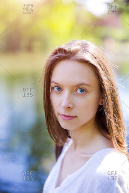 Portrait of attractive young woman outdoors