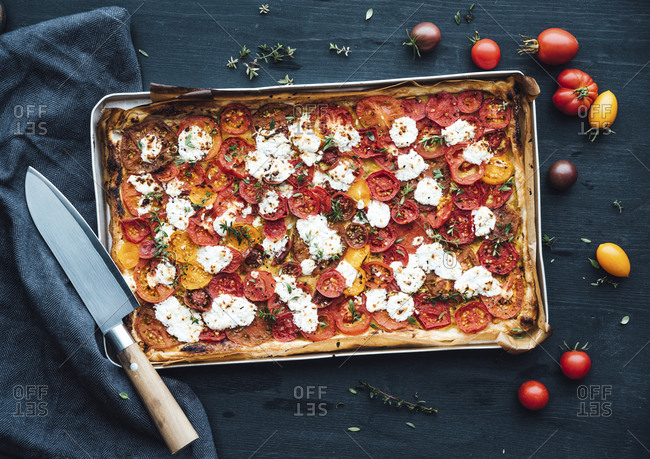 Tomato tart with goat cheese and thyme on mustard