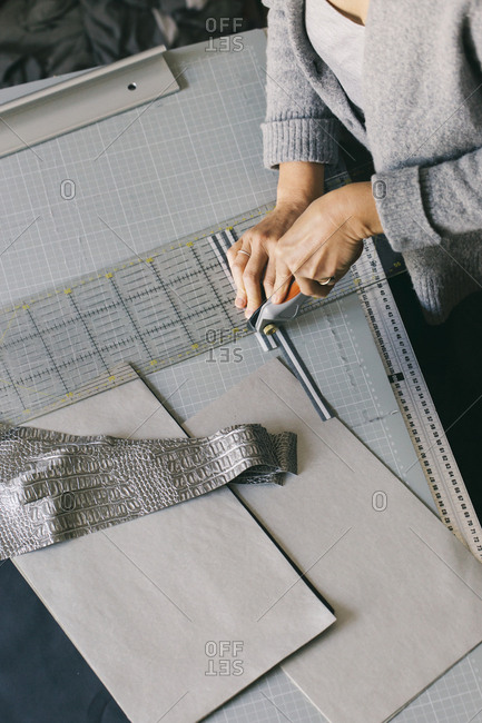 Close-up of fashion designer working on template
