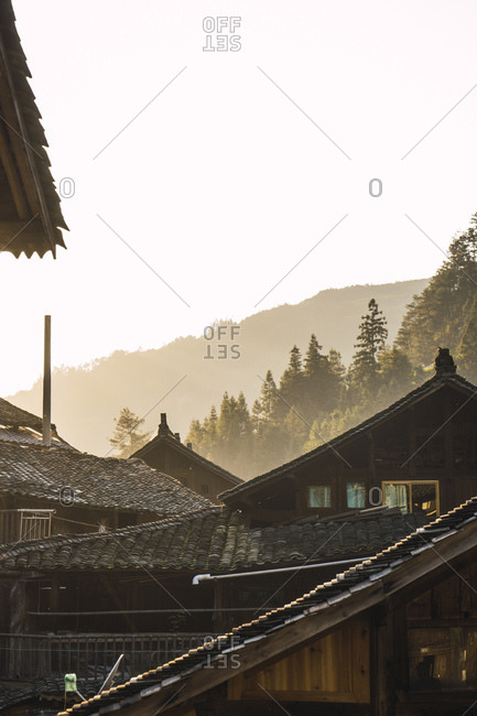 China- Guizhou- houses of a Miao settlement in backlight