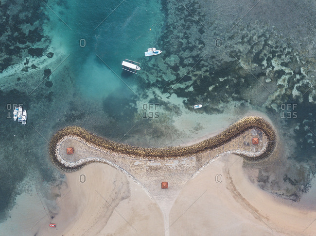 Indonesia- Bali- Aerial view of Nusa Dua beach- pier and boats from above