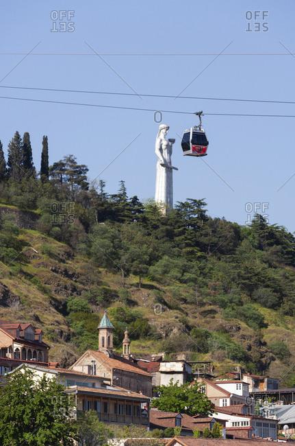 May 2, 2018: Georgia- Tbilisi- Cable car with Kartlis Deda monument