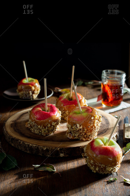 Caramel apples on a rustic farmhouse table