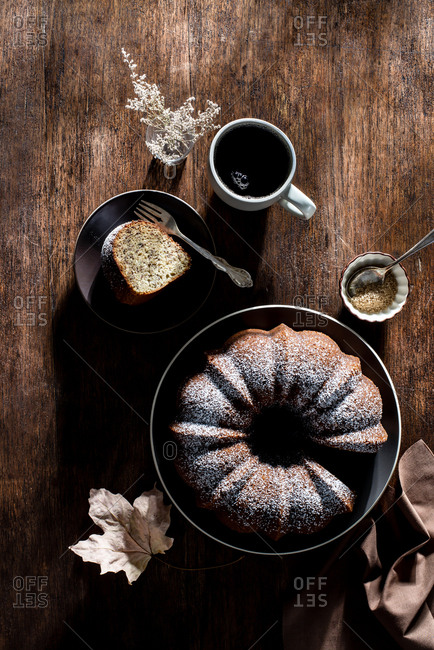 Bundt cake with coffee on a rustic farmhouse table in the autumn afternoon sun