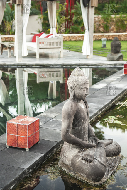 Asian style yard with Buddhist statues and reflecting pool