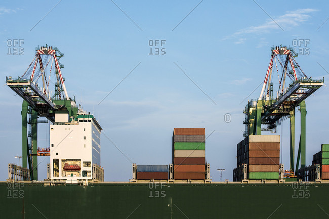 Loading cranes and cargo containers at industrial port