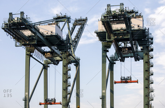 Two tall loading cranes at industrial port